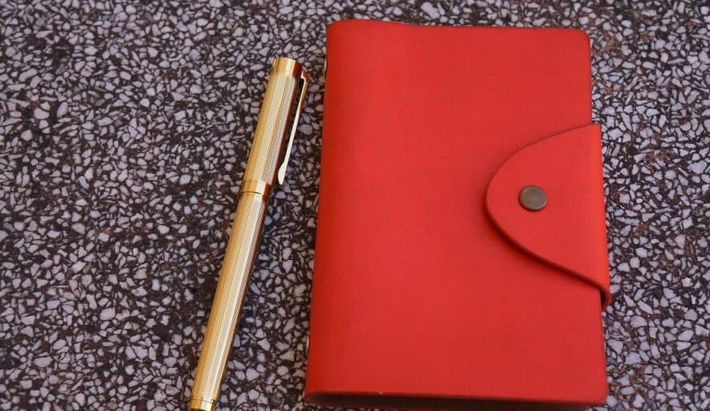 red journal and pen